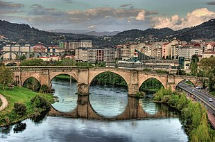 "View of the Roman bridge <a href=""http://search.lycos.com/web/?_z=0&q=%22Ponte%20Vella%22"">Ponte Vella</a>, in Ourense that traverses the <a href=""http://search.lycos.com/web/?_z=0&q=%22Minho%20River%22"">Miño</a> river"