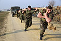 Romanian service members pull a Humvee during a squad competition with U.S. Marines assigned to Black Sea Rotational Force (BSRF) 14 in Mihail Kogalniceanu, Romania, Jan. 17, 2014 140117-M-DP395-003.jpg