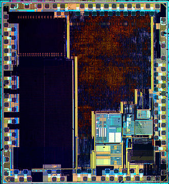ARM Cortex-M - Die from a STM32F100C4T6B IC. 24 MHz ARM Cortex-M3 microcontroller with 16 KB flash memory, 4 KB RAM. Manufactured by STMicroelectronics.