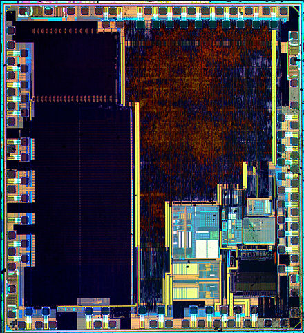 Die of a STM32F100C4T6B ARM Cortex-M3 microcontroller with 16 kilobytes flash memory, 24 MHz central processing unit (CPU), motor control and Consumer Electronics Control (CEC) functions. Manufactured by STMicroelectronics. STM32F100C4T6B-HD.jpg