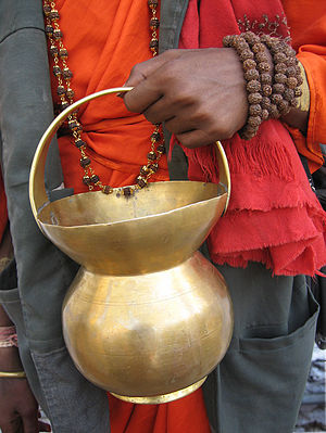 Kamandalu - A metal kamandalu, held by a sadhu