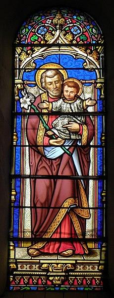 Vitrail de l'église de Saint-Ouën-des-Vallons (53). Saint-Joseph et l'Enfant Jésus.