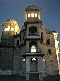 Monsoon palace at evening with interior lights on