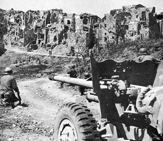 Battle of Monte Cassino - US soldiers with a 57mm M-1 anti-tank gun fighting near Monte Cassino during the initial assault.