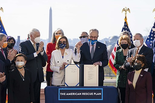 Senate Majority Leader Chuck Schumer (D-NY) and Speaker of the House Nancy Pelosi (D-CA) signing the American Rescue Plan Act. Photo by Senate Democrats.  Creative Commons Attribution 2.0 Generic license.