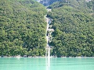 Última Esperanza Sound - Numerous streams tumble over the cliffs into the sound in fine cascades.