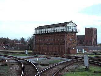 Severn Bridge Junction - The signal box as viewed from Shrewsbury station. Shrewsbury Abbey is in the background.
