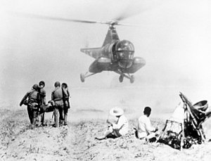 563d Rescue Group - Squadron H-5 preparing to evacuate soldier to a MASH