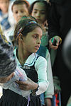 Soldiers, Iraqi national policemen distribute school supplies in Baghdad DVIDS157205.jpg