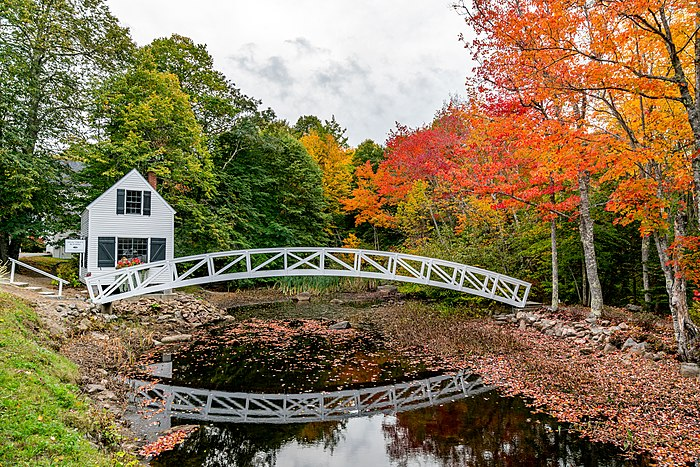 Selectmen's Building and its nearby historic foot bridge in the Somesville Historic District, Maine.