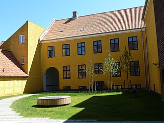 Sorø Art Museum - The old building seen from the courtyard with one of the round skylights of the underground level