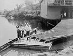 StateLibQld 2 123940 Rowers standing on the pontoon near the Brisbane Rowing Club in 1897.jpg
