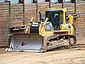 Stavební jáma Špejchar, buldozer Komatsu.jpg