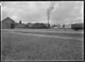 Steam locomotive and train at Lumsden Railway Station. ATLIB 292927.png