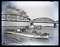 Steamboat Spread Eagle on the Mississippi River at St. Louis, passing under the Merchants Bridge.jpg