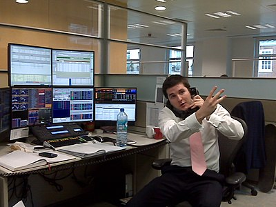 A stockbroker using multiple screens to stay up to date on trading Stockbroker.jpg