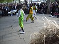 Street performers at the River Thames walkway in London.jpg