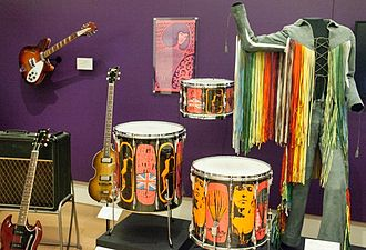 "A selection of instruments used by the Who, including a Rickenbacker and Gibson SG Special guitar, and Moon's ""Pictures of Lily"" drum kit from Premier Stuff from The Who (14165151158).jpg"