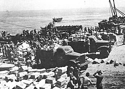 Supplies and equipment on the landing beach on Guadalcanal, 7 August 1942.jpg