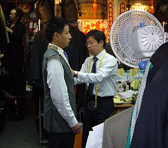 Sewing - A tailor fitting a suit in Hong Kong.