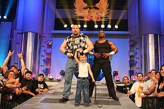 The Dudley Boyz - Team 3D with a fan.