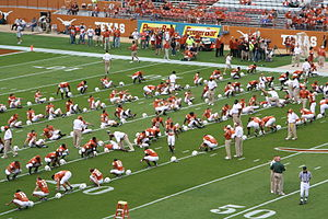 Texas football team doing warmups prior to Bay...