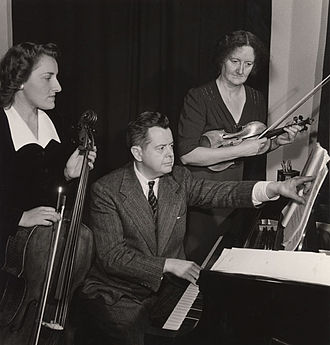 Ernest MacMillan - The Canadian Trio (left to right: Zara Nelsova, Sir Ernest MacMillan, Kathleen Parlow). Photo, c. 1941–1944. Source: Sir Ernest MacMillan Collection, Library and Archives Canada