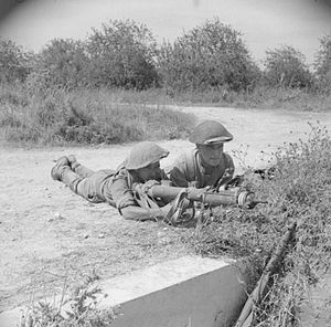 167th (1st London) Brigade - Men of the 9th Battalion, Royal Fusiliers manning a PIAT during the Battle of Salerno, 10 September 1943.