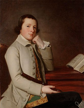 1750–1775 in Western fashion - George Romney's Young Man with a Flute wears a gold figured waistcoat under his coat. His breeches have buttons and buckles at the knee, 1760s.