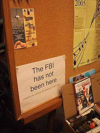 "Patriot Act - A notice posted in a library in 2005: ""The FBI has not been here (watch very closely for removal of this sign)"". Announcing the receipt of a National security letter would violate the associated gag order, while removing the sign would not."