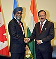 The Minister of State for Defence, Dr. Subhash Ramrao Bhamre meeting the Canadian Defence Minister, Shri Harjit Singh Sajjan, at Vancouver, Canada on November 14, 2017.jpg