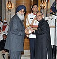 The President, Shri Pranab Mukherjee presenting the Padma Vibhushan Award to the Chief Minister of Punjab, Shri Parkash Singh Badal, at a Civil Investiture Ceremony, at Rashtrapati Bhavan, in New Delhi on March 30, 2015.jpg