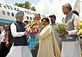 The Prime Minister, Dr Manmohan Singh being welcomed by the Chief Minister of Uttar Pradesh, Km. Mayawati, on his arrival at Chakeri Airforce Station, Kanpur on July 03, 2010.jpg