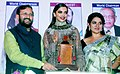 "The Union Minister for Human Resource Development, Shri Prakash Javadekar presenting the Giants Award to Ms. Deepika Padukone for films field, at the ""44th Giants Day Celebration"", in Mumbai on September 17, 2016.jpg"