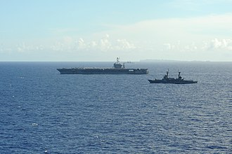 Humanitarian response to Typhoon Haiyan - The aircraft carrier USS George Washington (CVN 73), left, moves alongside the Philippine frigate BRP Gregorio del Pilar (PF-15) in the Philippine Sea Nov. 17, 2013, during Operation Damayan.