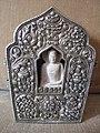 Tibetan gau made of silver with eight auspicious symbols and stone figurine of Buddha, early 20th century.jpg