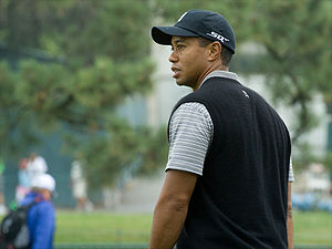 A view of Tiger Woods as he walks off the green