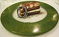 Tiramisu on a speckled green plate, July 2007.jpg