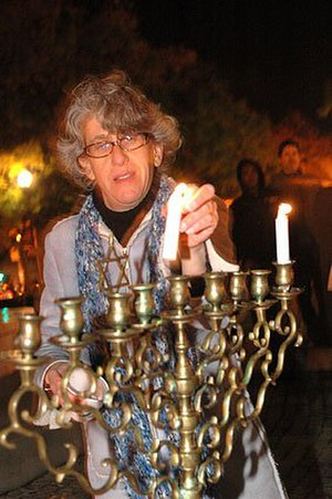 Bet Mishpachah - Rabbi Toby Manewith, Spiritual Leader of Congregation Bet Mishpachah, lights the Hanukkah Menorah on World AIDS Day, 2010