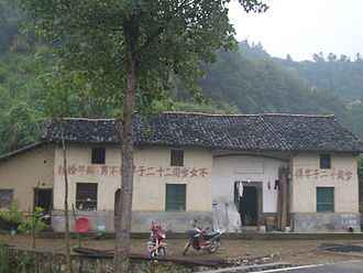 Marriageable age - The sign painted on a building in a village in Hubei, China, informs of the marriageable age in the country (22 for men, 20 for women).