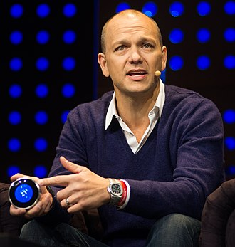 Tony Fadell - Fadell holding the Nest Learning Thermostat