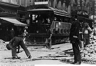 Toronto Police Service - A constable overlooks construction for streetcar lines on Adelaide and Yonge Street, 1911.