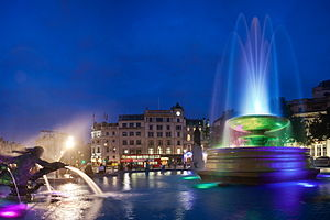 LED fountains of Trafalgar Square in London, England, showing different colours