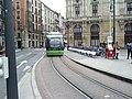 Tram passes by bikeshare station (18188171883).jpg