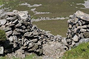 Prehistoric Wales - Entrance through the dry-stone rampart, Tre'r Ceiri hillfort, Gwynedd