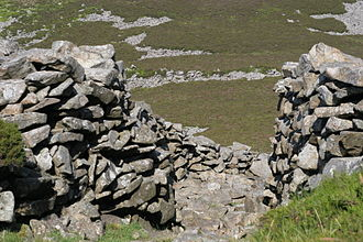 Prehistoric Wales - Entrance through the dry-stone rampart, Tre'r Ceiri hillfort, Gwynedd