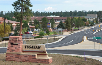 Tusayan, Arizona - The Tusayan welcome sign with town behind