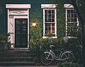 Two bicycles near a house (Unsplash).jpg