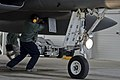 U.S. Air Force Senior Airman Jared Gregory, a weapons load crew member with the 48th Air Expeditionary Group, performs preflight checks on an F-15C Eagle aircraft assigned to the 493rd Expeditionary Fighter 140319-F-XB934-137.jpg