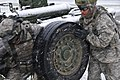 U.S. Army Spc. Frederico Lara, right, with Charlie Battery, Field Artillery Squadron, 2nd Cavalry Regiment (CAV), and a fellow Soldier move the tire arm on an M777 155 mm howitzer during a decisive action 121027-A-TF309-002.jpg